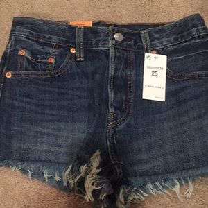 Levi 501s.  Button fly jean cut off's shorts.